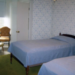 Shaw house room showing beds and chair