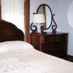 Bird-Werner room showing full sized bed and dresser near window