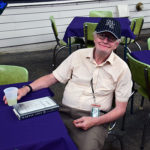Gentleman stting at table with lemonade during porch blessing