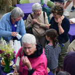 Ladies enjoying conversation and refreshments during porch blessing