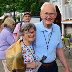Couple smiling for photo dusing porch blessing dedication
