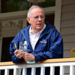 David Matthews on Bird-Werner porch during porch blessing dedication