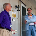 Jack Knepp and Bob Tupaj visiting on Shaw porch during porch lessing ceremony