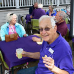 Tom Kerns and Matilda enjoying refreshments and conversation during porch blessing dedication