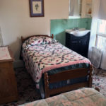 Westervelt house room showing additional single bed plus dresser and sink