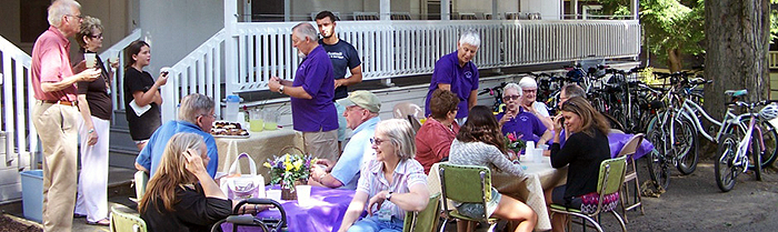 Ecumenical community denominational social in front of shaw and bird werner houses