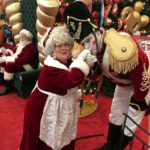 Mrs Claus with person playing toy soldier