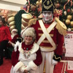 Mrs Claus posing with person posing as toy soldier